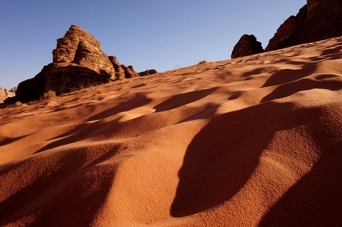 Shadows in the desert sand of Wadi Rum Jordan.