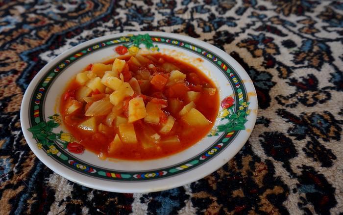 A potato, onion, and tomato dip we ate with pita.