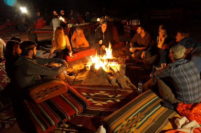 Sitting around the fire while camping under the stars in Wadi Rum, Jordan.