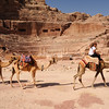 Camels pass in front of the Amphitheatre, Petra