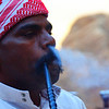 Today's travel image from the Middle East is of a Jordanian Bedouin man smoking hookah shisha early in the morning outside our camp in Wadi Rum, Jordan.
