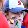 Getting a spider painted on his cheek is Theo Fortin, 3, of Westford at the Joseph Middlemiss Big Heart Foundation's 4th annual Celebrity Scoop Fest at Shaw Farm in Dracut on Wednesday, June 21, 2017. SUN/JOHN LOVE