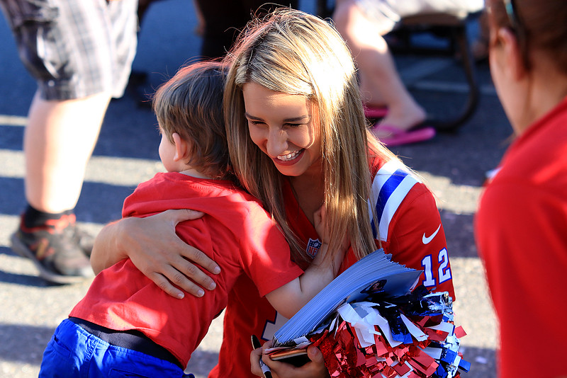 Patriots Cheerleader Nicole Manelas, 22, of Pelham N.H. gets a hug from Tommy Klemm, 3, also from Pelham at the Joseph Middlemiss Big Heart Foundation's 4th annual Celebrity Scoop Fest at Shaw Farm in Dracut on Wednesday, June 21, 2017. SUN/JOHN LOVE
