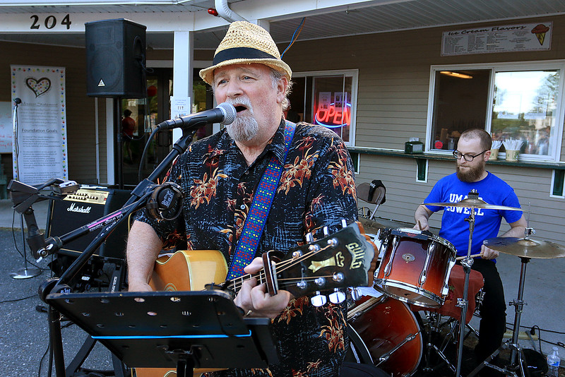 "Dave Norton sings with the band ""Well Respected Men"" while his son Adam Norton plays the drums behind him as they entertain the crowd at the Joseph Middlemiss Big Heart Foundation's 4th annual Celebrity Scoop Fest at Shaw Farm in Dracut. SUN/John Love"