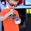 Griffin DaDalt, 2, of Westford enjoys his ice cream at the Joseph Middlemiss Big Heart Foundation's 4th annual Celebrity Scoop Fest at Shaw Farm in Dracut. SUN/JOHN LOVE