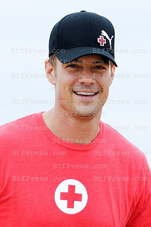 Josh Duhamel runs for the American Red Cross on Santa Monica Beach. Ford Company annouces donations of $1million