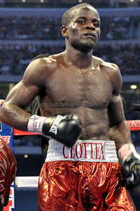 "12 Rounds - WBO World Welterweight Title: Joshua Clottey (147 lbs) Accra, GHA (35-3, 21 KOs) Trunks: Red & White, 32, 5'8"", 70"" [Corner: Lenny DeJesus, Bismark Bruce, Kwaku Gyamfi, Vincent Scolpino]"