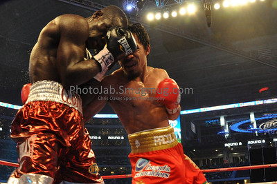 "12 Rounds - WBO World Welterweight Title: Joshua Clottey (147 lbs) Accra, GHA (35-3, 21 KOs) Trunks: Red & White, 32, 5'8"", 70"" [Corner: Lenny DeJesus, Bismark Bruce, Kwaku Gyamfi, Vincent Scolpino] vs. Manny Pacquiao (145 3/4 lbs) General Santos, PHI (50-3-2, 38 KOs) Trunks: Red s/White, 30, 5'6"", 67"" [Corner: Freddie Roach, Miguel Diaz, Restituto Bouboy Fernandez, Alex Arisa]"