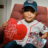 Josmaily Luzon Cruz, 6, shows off a signed stuffed heart and commemorative patch given to him by David Ortiz during a pre-game ceremony held on Sunday afternoon, Ortiz's last home game as a member of the Boston Red Sox. Cruz receiving life-saving heart surgery paid for through the David Ortiz Children's Fund in September 2014. SENTINEL & ENTERPRISE / Ashley Green