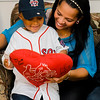 Josmaily Luzon Cruz, 6, smiles as he looks down at a stuffed heart signed by David Ortiz during a pre-game ceremony held on Sunday afternoon, Ortiz's last home game as a member of the Boston Red Sox. Cruz receiving life-saving heart surgery paid for through the David Ortiz Children's Fund. SENTINEL & ENTERPRISE / Ashley Green