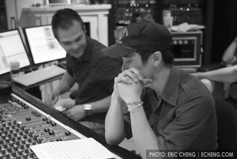 Alex Wong studies arrangements in preparation for recording