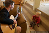 Ian and Rowland play the guitar