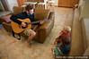 Ian plays guitar for the toddlers