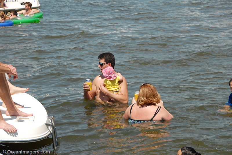 Charlie and Niki teaching Amanda how to swim... or drink beer... well, maybe both! :-)