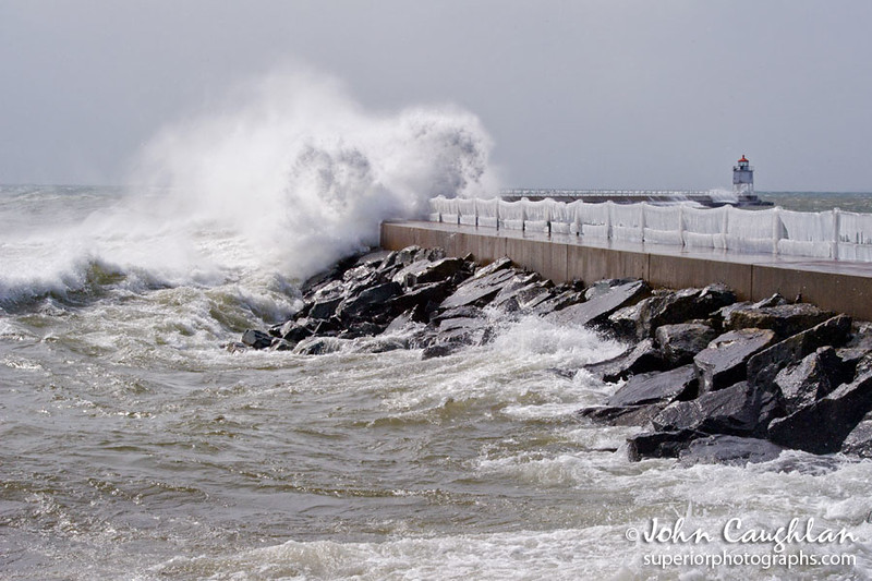A major winter storm was bearing down on Lake Superior, and I drove up to get a front row seat to the event. First stop, the break wall in Two Harbors. The beginning of storm brought 40 mph winds.