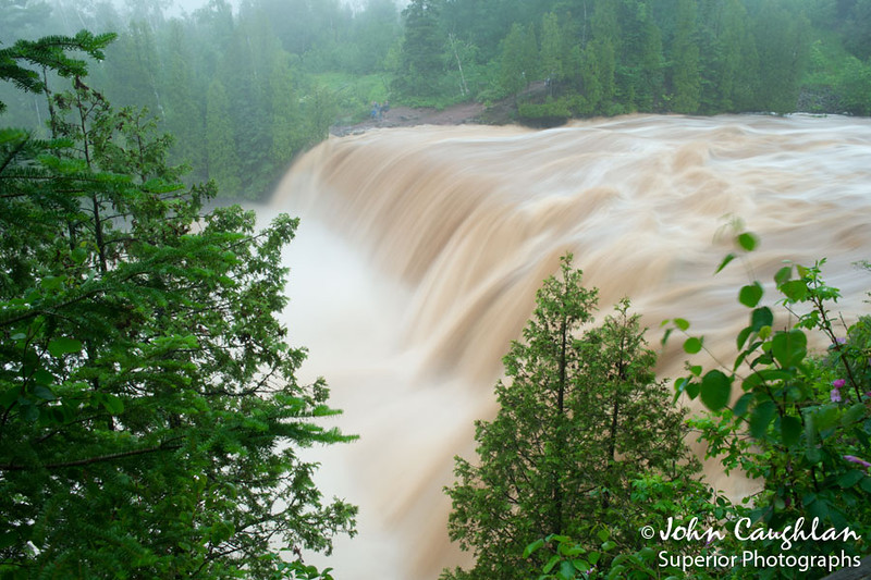 On June 19-20, 2012,  the Duluth area received 10-12 inches of rain. This was a once in my lifetime opportunity that I could not pass up, so I loaded up the truck and headed for the north shore. I was hearing reports interstate 35 and highway 61 were closed. Going through Duluth, or even around it, would prove impossible. So I decided to head towards Grand Rapids and work my way over to Virginia and Hibbing then down to Silver Bay. Many of the roads were flooded and I was detoured countless times. After five hours of driving I finally arrived at Gooseberry State Park. I could hear the roar from the river from inside my truck. I grabbed my camera gear, an umbrella, and headed for the river. I arrived at Middle Falls and river water seemed to be going in every direction. It was impressive to see Gooseberry filled above capacity.