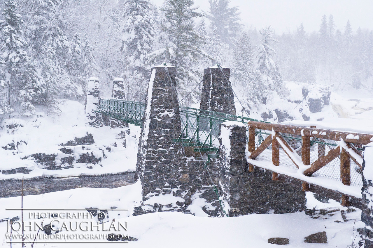 I stopped at Jay Cooke State Park and took some images of the new swing bridge covered in snow. The snow was caked on everything.