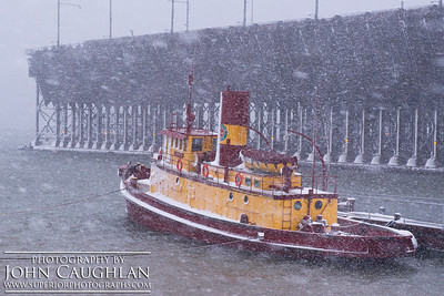 I waded in waist deep snow down to the harbor and took this image of the Edna G. tugboat. My face was wind burned and red from the driving snow.