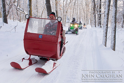 Dave taking his old Arctic Cat for a little ride in the woods.