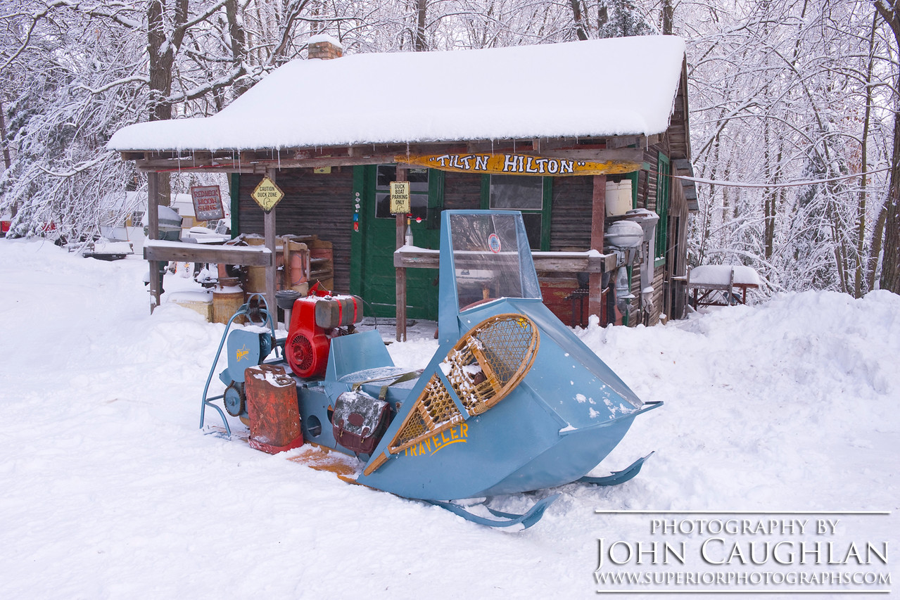 An old Polaris Snow Traveler. The snowshoes are in case your snowmobile breaks down and you have to walk home.
