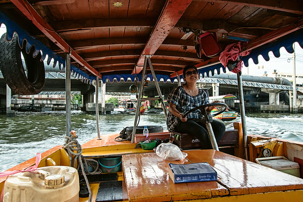 A happy thai woman, taking us around in Bangkok.
