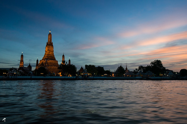 Wat Arun (Temple of Dawn) from the Chao Phraya river in Bangkok. The beautiful pagoda in the sunset was breathtaking.