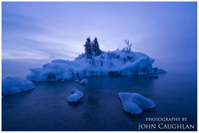 The following morning I woke up to -32 with a wind chill of -63. It hasn't been this cold for a long time. After getting my truck started, I drove up to Hollow Rock for sunrise. There wasn't a great sunrise, but I really liked the moody blues of the water, sky, and the ice.