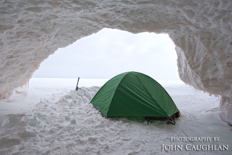 We set up base camp under a ice cave. Below the snow was frozen lake superior. We camped, slept, and ate on the ice. During the day we would explore the ice caves and take pictures. It was very eerie not seeing anybody for days.