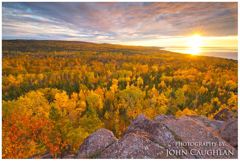This image was taken from Pincushion Mt. in Grand Marais. A perfect amount of clouds, peak fall colors, and a colorful sunrise made this image worth the hike.