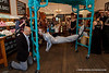 Performance artist Alice Newstead hangs from shark hooks to bring attention to the unsustainable practice of shark finning. LUSH Cosmetics in San Francisco.