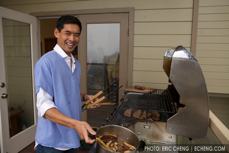 """Dave mans the BBQ, wearing his """"apron"""""""