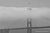 A B-2 stealth bomber flies above the Golden Gate Bridge. Fleet Week in San Francisco, CA. October 8, 2011.