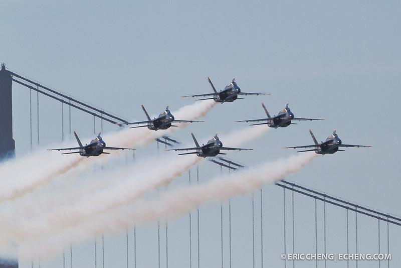 Blue Angels buzz the Golden Gate Bridge with contrails. Fleet Week in San Francisco, CA. October 8, 2011.