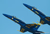 Two Blue Angels position their jets at an angle while flying straight and slow. Fleet Week in San Francisco, CA. October 8, 2011.
