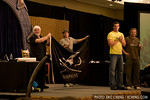 Captain Paul Watson, Corin Nemec, Dan Payne, and Alex Zaraha on stage, auctioning off a Sea Shepherd flag