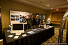 Adam Lau, Eric Cheng, and Kim McCoy prepping the booth at Gatecon