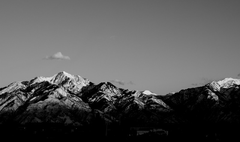 10/365 Feb 17 2011 Mountains from Murray.  At sunset I found a field a few blocks from my home with a mostly un-obstructed view of the Wasatch mountains. I really liked the color on the mountains, but decided to try a black and white rendering. I loved and kept it.<br /> <br /> Pentax K7 SMC FA 50mm f1.4 lens shot at ISO 100, f8, 1/100 second. Processed in Adobe Photoshop Lightroom 3