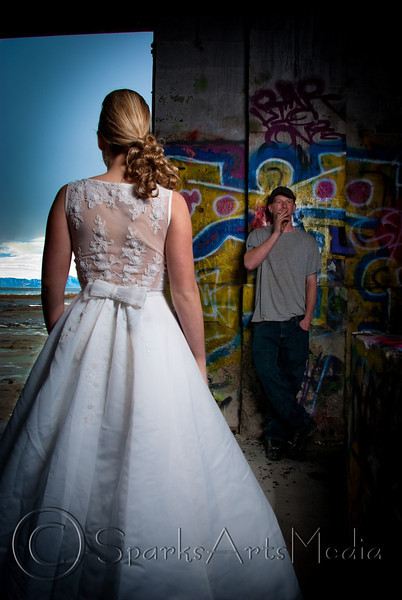 "Trash the Dress is a popular style of wedding photography, usually done after the wedding because the locations and events of the shoot are hard on the dress. In this shoot, we went out to the Great Salt Lake to an abandoned wear house. It was very dark inside the building, but there was all this cool graffiti. Her boyfriend smokes, so I asked him to stand were he is in the photo and light up.  I was trying to create a piece that was kind of bitter sweet with him being detached from the whole scene. We lit the bride with a single strobe on a stand with an umbrella.  More of her shoot is here: <a href=""http://sparky.cc/Weddings/Raymie-Trash-the-Dress/11110967_jij5h#778265381_RenBn"">http://sparky.cc/Weddings/Raymie-Trash-the-Dress/11110967_jij5h#778265381_RenBn</a>"