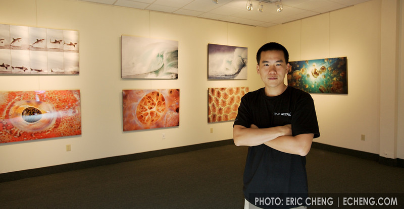 Eric Cheng in front of his aluminum underwater photography prints (photo: Wendy Cheng)