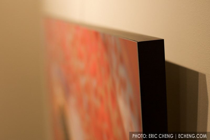 Detail of the side of a framed print. The thin aluminum is mounted flush against the aluminum frame.