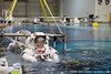 An astronaut is lowered into the water for a training mission at the NASA Neutral Buoyancy Lab in Houston, Texas