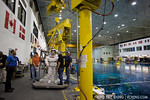 An astronaut is prepped to enter the water for a training mission at the NASA Neutral Buoyancy Lab in Houston, Texas
