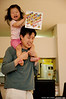 Ella Kim goes for a ride on Daddy's shoulders