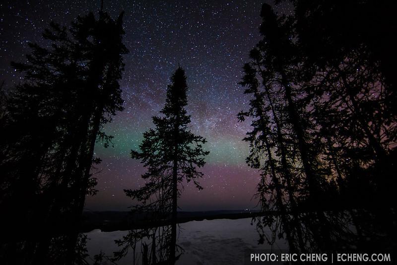 Starry night sky with faint northern lights. Fairbanks, Alaska.