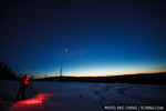 Photographer Julian Cohen takes pictures of the dusk sky. Fairbanks, Alaska.