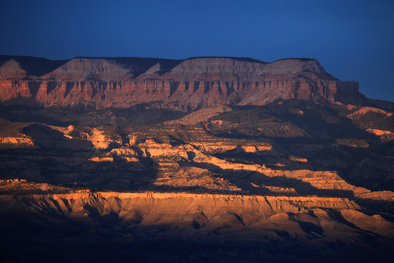 "FRIDAY, APRIL 10, 2009<br /> <br /> UTAH 9504<br /> <br /> ""Evening Illumination""<br /> <br /> After exploring Willis Creek yesterday I drove on towards Bryce Canyon and stayed in a nice motel a few miles west of the park. I shot the sunset from the Bryce Point overlook, which is a short distance into the park and is one of the main overlooks. The sunset was amazing, and a little cold. There was a stiff west wind blowing and I got pretty chilled standing on the canyon rim in the wind.<br /> <br /> I drove the few miles from the motel back to Bryce this morning, this time choosing to shoot from the Fairyland Canyon viewpoint. I like the Fairyland area because most people miss it, as it is actually before the park entrance station. The view, however, is no less stunning than the other, more ""popular"" views in the park.<br /> <br /> I didn't spend much time at Bryce on this trip, as I've been there a few times before and my main focus this time was to catch one sunset and one sunrise at the park. I didn't really do any hiking this time, although the trails at Bryce are wonderful. If you ever visit this park, the Navajo Trail is my favorite. You descend down into the canyon and once at the bottom the canyon walls are quite high and there are pine trees growing within the canyon. Its awe-inspiring to be down on the canyon floor and looking up at the sky beneath one of those pines.<br /> <br /> Camera: Canon EOS 5D Mark II<br /> Lens: Canon EF 100-400mm<br /> Focal length: 235mm<br /> Shutter speed: 1/200<br /> Aperture: f/5<br /> ISO: 200"