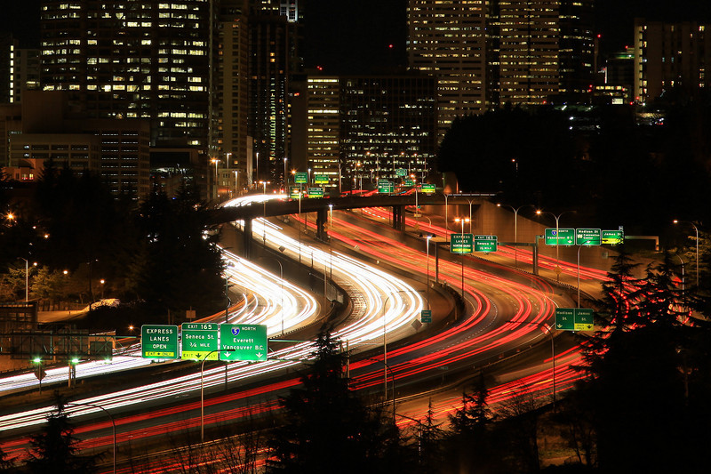 "MONDAY, DECEMBER 7, 2009<br /> <br /> WASHINGTON 2084<br /> <br /> ""The Rat Race""<br /> <br /> I like to call this image ""The Rat Race"". It's an 8 second exposure of traffic flowing through downtown Seattle at rush hour.<br /> <br /> Camera: Canon EOS 5D Mark II<br /> Lens: Canon EF 24-105mm<br /> Focal length: 105mm<br /> Shutter speed: 8 seconds<br /> Aperture: f/10<br /> ISO: 100"
