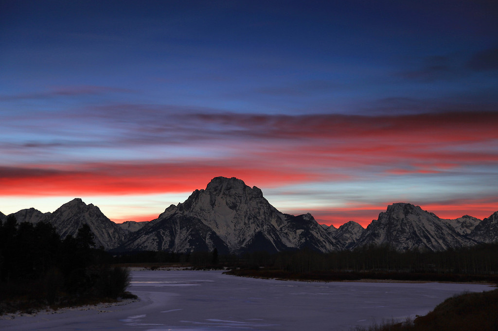 "TUESDAY, DECEMBER 1, 2009<br /> <br /> WYOMING 0878<br /> <br /> ""Last light on the Tetons""<br /> <br /> This image of Mt. Moran at Oxbow Bend was captured about 45 minutes after the sun went down. There was still quite a bit of color left in the sky, and it was already dark enough and the moon was light enough that the mountains were lit up from the light of the rising moon.<br /> <br /> Camera: Canon EOS 5D Mark II<br /> Lens: Canon EF 24-105mm<br /> Focal length: 65mm<br /> Shutter speed: 15 seconds<br /> Aperture: f/4<br /> ISO: 200"