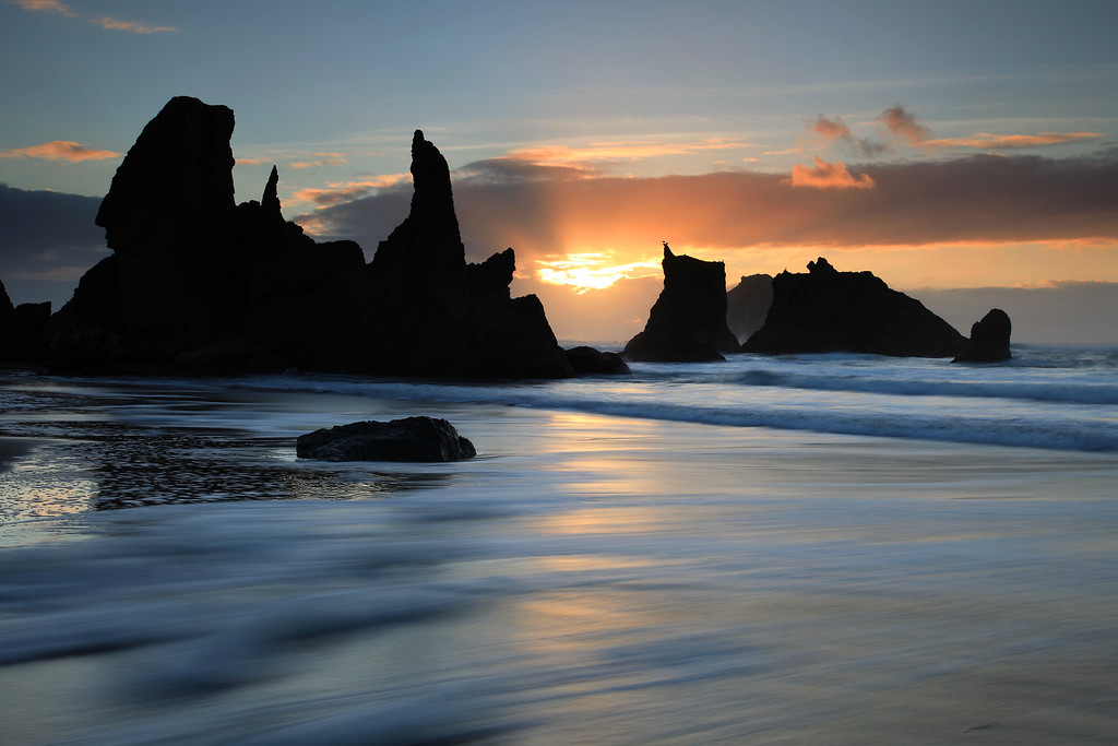 "MONDAY, DECEMBER 21, 2009<br /> <br /> OREGON 3524<br /> <br /> ""Coast of Wonders""<br /> <br /> I shot two sunsets along the beaches at Bandon and on the first evening I got pretty wet. Right after the sun went down some rain squalls quickly moved in and got me good and wet before I was able to make it back to the car. Even though I was wearing my rain jacket, I didn't have any rain pants so my pants got soaked. The second evening was free from rain and I was treated to some wonderful light as the sun retreated over the horizon. <br /> <br /> Camera: Canon EOS 5D Mark II<br /> Lens: Canon EF 24-105mm<br /> Focal length: 45mm<br /> Shutter speed: 1 second<br /> Aperture: f/16<br /> ISO: 50"