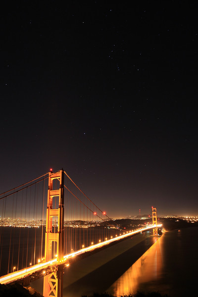 "FRIDAY, DECEMBER 25, 2009<br /> <br /> CALIFORNIA 3805<br /> <br /> ""Orion above the Golden Gate""<br /> <br /> Well, I wasn't sure where I would be for Christmas... as luck would have it, I found myself in San Francisco on Christmas Eve. I spent the evening at Golden Gate National Recreation Area, overlooking the Golden Gate Bridge. I love the Golden Gate Bridge, and it was one of the things I was wanting to photograph again on this trip. Much to my surprise, when I arrived at the area overlooking the bridge I could see a few stars in the sky! I was certain that the city lights would be too bright to be able to see any stars, but thankfully I was wrong. I managed to make an image of the bridge with the constellation Orion visible in the sky above. It was the perfect Christmas gift. <br /> <br /> Even though I was ""alone"" on Christmas, I felt like you were all with me. I received many emails from my friends, followers and supporters wishing me a Merry Christmas. Thanks to you all who took the time to send me a message. Your wishes were much appreciated and made me feel like I was home. I hope you all had a very Merry Christmas as well!<br /> <br /> Camera: Canon EOS 5D Mark II<br /> Lens: Canon EF 17-40mm<br /> Focal length: 17mm<br /> Shutter speed: 30 seconds<br /> Aperture: f/8<br /> ISO: 400"